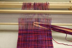 Weaving on a rigid heddle loom.