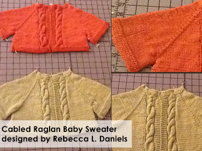 Cabled Baby Sweater designed by Rebecca L. Daniels