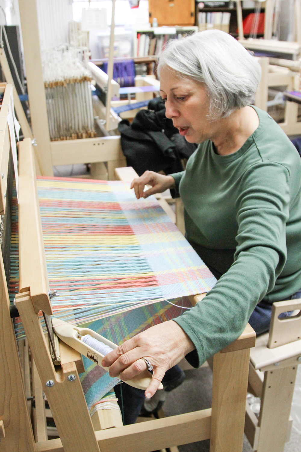 January 30, 2014 -- Local weaver Vicki Patillo weaves the first of 5 blankets that will be donated to Help Our Kids, a local nonprofit organization for foster children. Patillo is one of several members of the Pioneer Valley Weavers Guild who are donating their time.